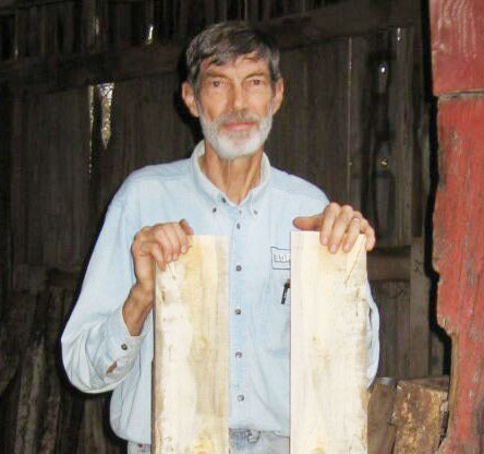 Here's Jim with two of the very first boards he sawed with his TimberKing mill — Silver Maple.