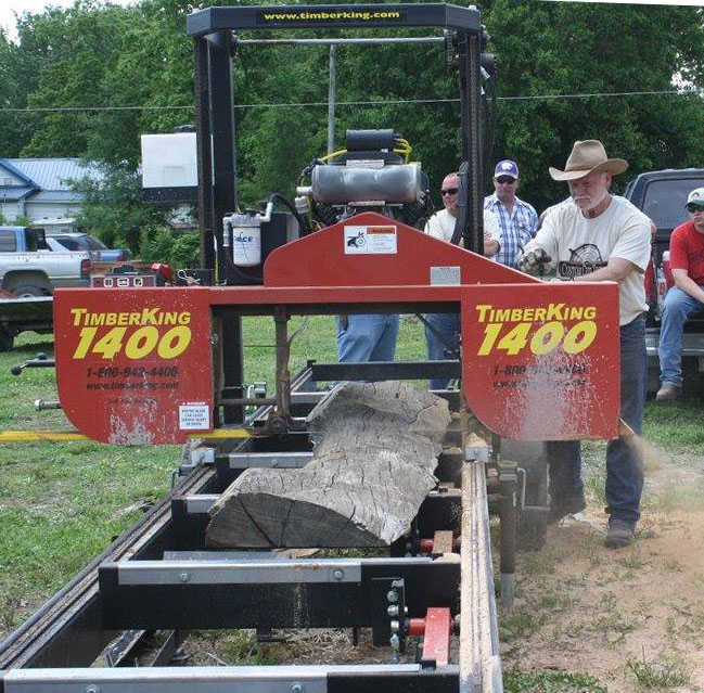 Dave Prescott shows off his sawing skills at a fair near home. He finds craft fairs and shows are an excellent way to get his name out there.