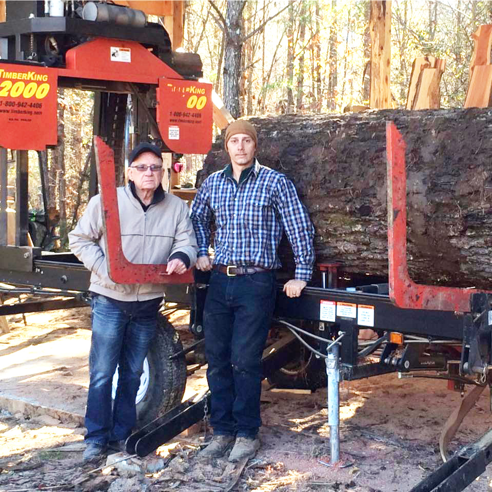 Chad and his dad with Chad's TimberKing 2000. The log? A 220-year old oak blow-down