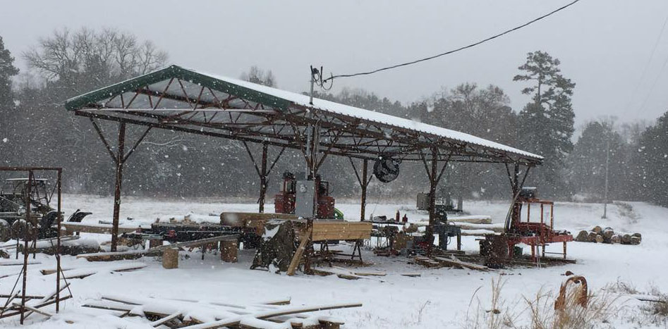 Think it never snows in Arkansas? Think again. Tom's shelter keeps the sun, rain, and snow off his TK mill.