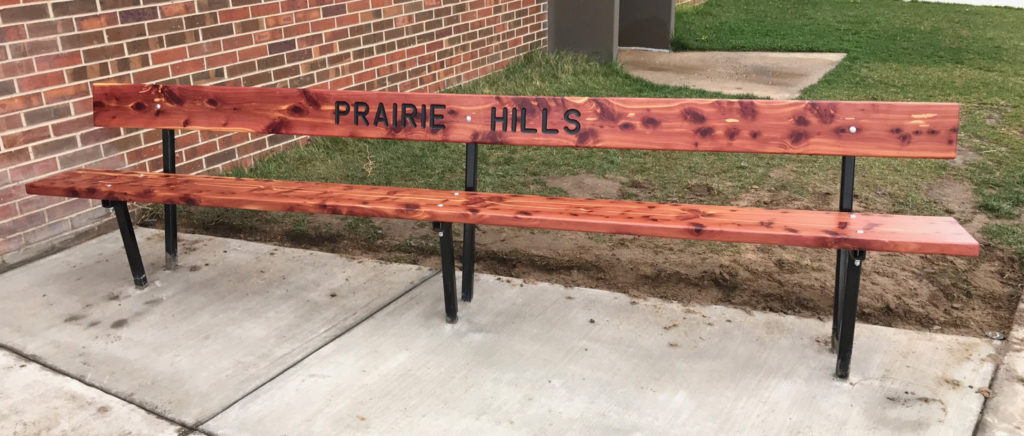 Ol' Doc and his son built this bench as his son's Eagle Scout project. It's installed at his son's old school — now the kids can chill out as they wait for the bus.