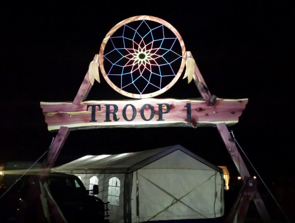 """Bryan sawed the cedar that he and other Boy Scout leaders used to build this award-winning """"gateway"""" for their troop's campouts and jamborees."""