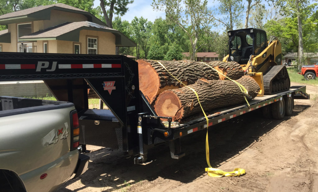 Big day at Ol' Doc's saw lot as he hauls in another big load of logs with his gooseneck trailer and dually.