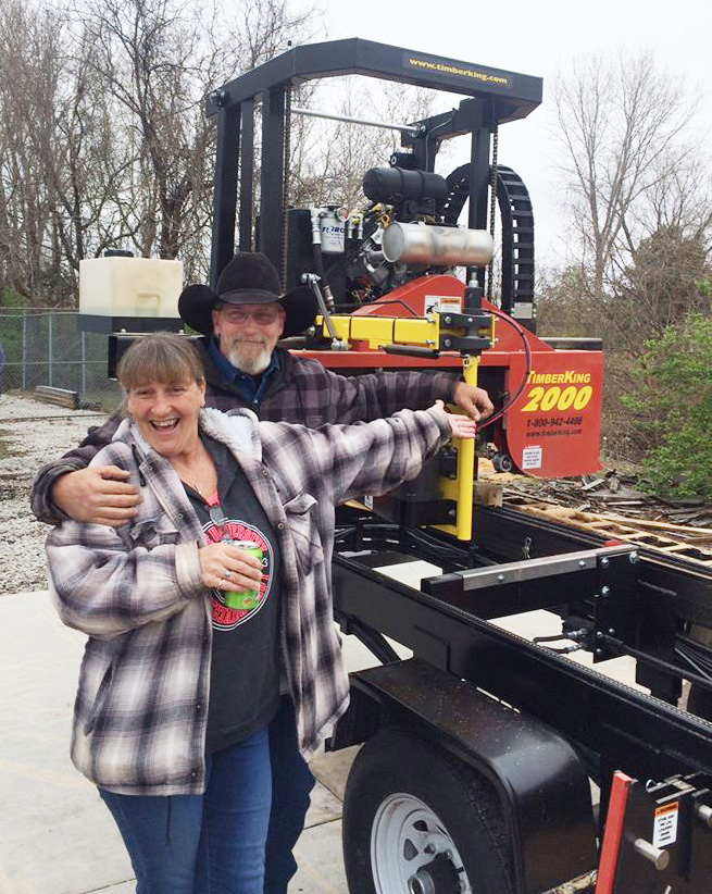 HAPPINESS is a brand new TimberKing 2000. New customers, Kevin and Diane Hill picked up their mill at our factory and towed it home.