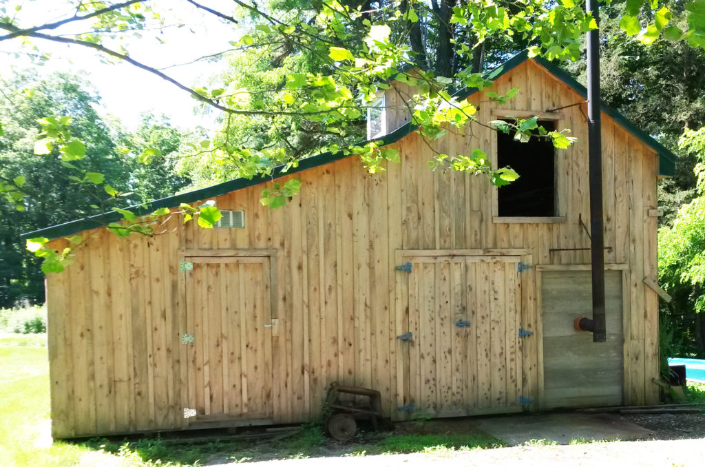How'd you like a nifty outbuilding like this one? Steve built it with lumber he milled and edged with his TimberKing equipment. Looks like Steve put a woodstove inside to keep things toasty on those cold winter days in the northeast.