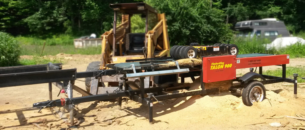 Here's Steve's TimberKing Talon Edger. He sets it up as a gang saw and can rip one wide board into four or five 2x4s. Cuts his production time at least in half.