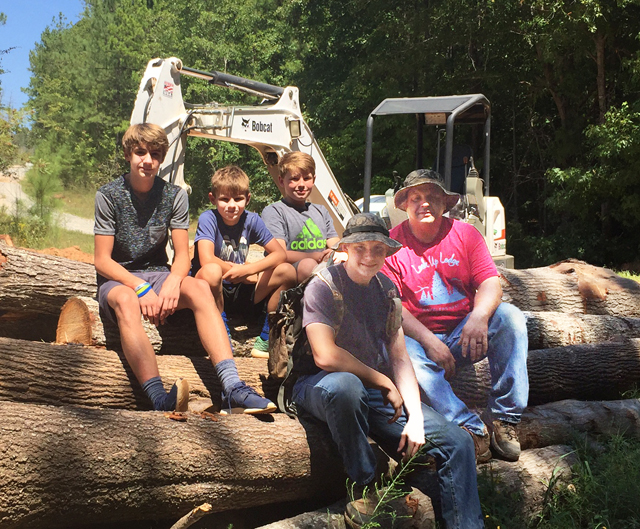 Meet the Hopper boys - tomorrow's TimberKing sawyers. Left to right: Logan, Preston, Kyler, and Selik. John's, at right, is duly proud of his four sons.