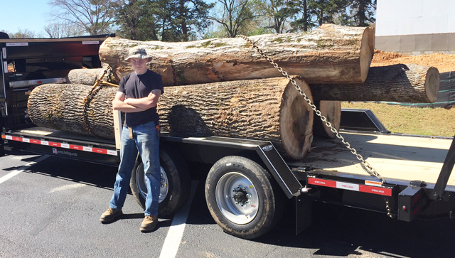 This TimberKing sawyer shows off a healthy loads of logs on their way to the Hopper sawlot.