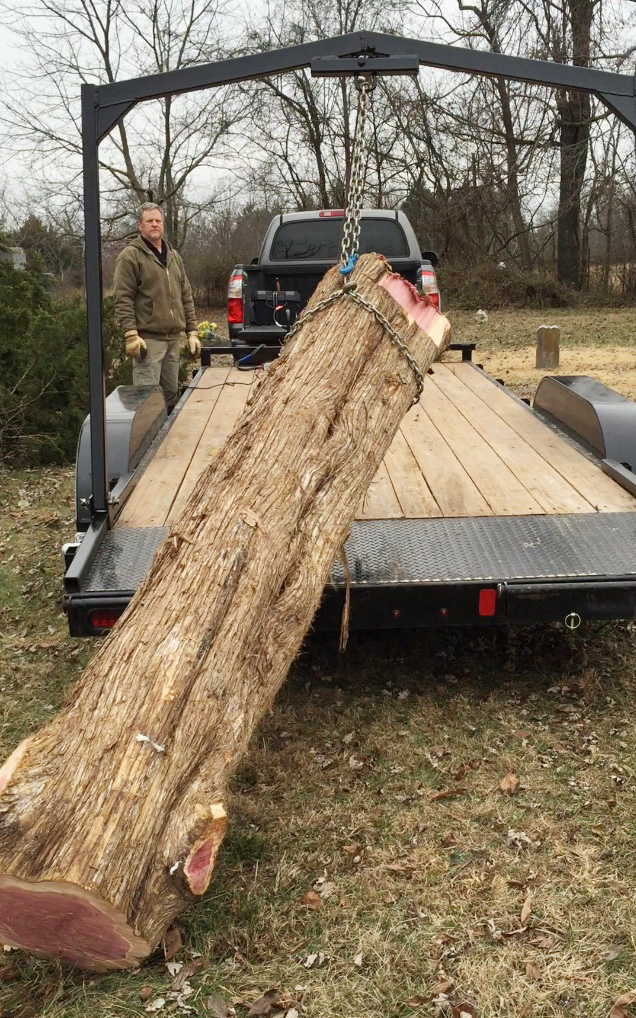 What would you pay for a cedar log like this one? Charles paid $0. He's bought only one log in the time he's been sawing. Folks are glad to have him haul them away.