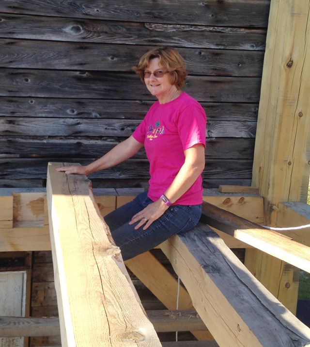 Rhonda's putting hemlock and pine ceiling beams in place in their 24' x 14' addition. Today, the downstairs is finished off while the upstairs is still a work in progress.