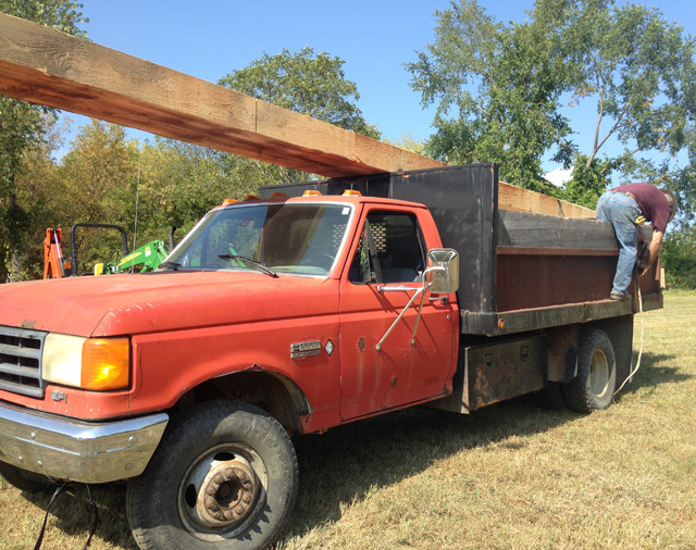 "Here's Hank strapping down two 24' beams he sawed out with his TimberKing. The vehicle? ""THE BEAST"" is Hank's 1988 dump pickup."