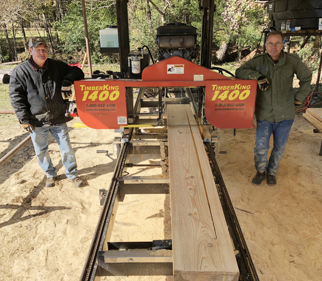 Bryan (right) and his brother John with their 1400 TimberKing sawmill