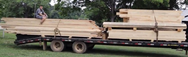 It takes a whole family to raise a barn and a whole lot of wood from their TimberKing mill. A young Andries hops a ride on the lumber trailer -- just a fraction of what the family sawed