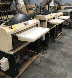 """The Biglers have 3 Woodmaster Molder/Planers. Their 25"""" model is set up as a dedicated planer. One of their 18"""" 718's has a 3-side Molding System attachment. The second 718 is set up for full-time molding."""