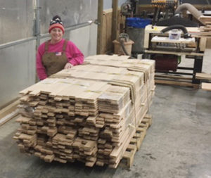 """Amy works right alongside Robert. """"I'm a mega Martha Stuart do-it-yourselfer,"""" she says. """"I've driven tractors, forklifts, and been around construction for decades."""" These days, you might find Amy running the couple's TimberKing."""