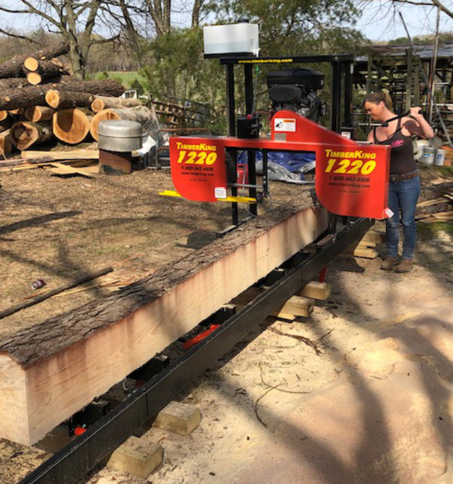 """Sawing's all in a day's work at the Hand farm. Brianna says, """"It's easy and fun."""""""